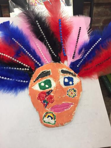 Young Masters Art Class:  Artist of Inspiration Gil Grimmett.  Mask created with air dry class, feathers and other collage materials.